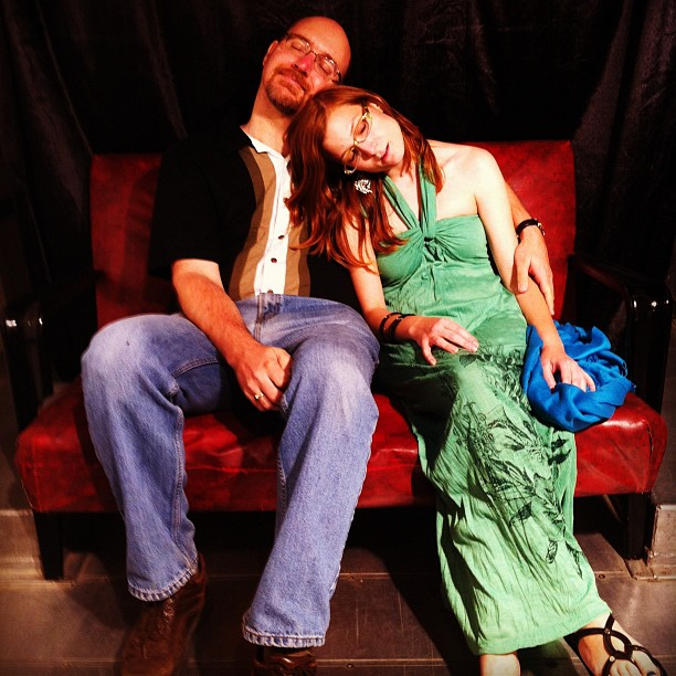 Photograph of me and Jacqui Vandale, asleep on a red couch